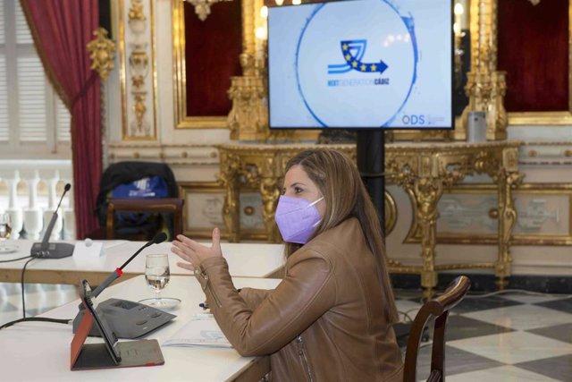 Irene García con el logo de la Next Generation al fondo