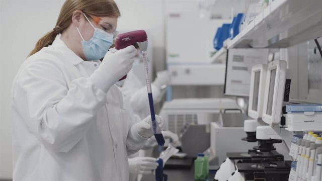 HANDOUT - 16 November 2020, US, ---: A screengrab taken from undated video issued by Moderna shows a scientist working on the Moderna coronavirus vaccine. The US pharmaceutical firm said early analysis suggests its Covid-19 vaccine is 94.5-per-cent effect