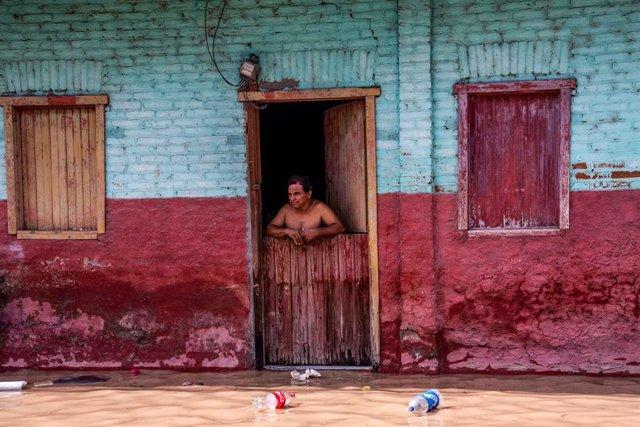 19 November 2020, Honduras, La Lima: A man stands at the door of his house after the devastating hurricane Iota made landfall in Honduras. Photo: Seth Sidney Berry/SOPA Images via ZUMA Wire/dpa
