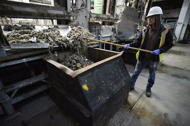 April 12, 2019 - New York, New York, United States: Sewage treatment worker Kam Lau works the solid waste inside the Newtown Creek Water Pollution Control Plant at 329 Greenpoint Avenue, in Brooklyn. Deputy Commissioner Pam Elardo claims that 80 to 90 per