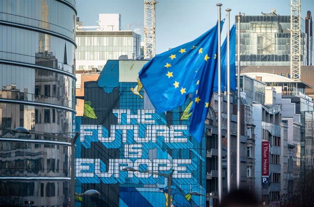 """29 January 2020, Belgium, Brussels: European flags wave near a mural painting with the inscription of """"The Future is Europe"""". Britain is due to leave the EU at midnight on Friday, three-and-a-half years after Britons narrowly voted on the issue in a 2016"""