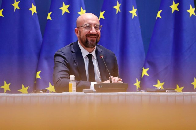 HANDOUT - 07 December 2020, Belgium, Brussels: EU Council President Charles Michel attends a video conference meeting with President of the European Commission Usrsula von der Leyen, German Chancellor Angela Merkel and French President Emmanuel Macron. Ph