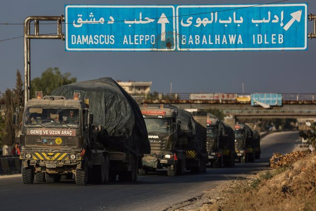 20 October 2020, Syria, ---: Military vehicles of the Turkish troops drive on the M4 Motorway, near the city of Arihah, after they began their withdrawal from their largest observation point in Syria, located in the town of Morek, which now falls under th
