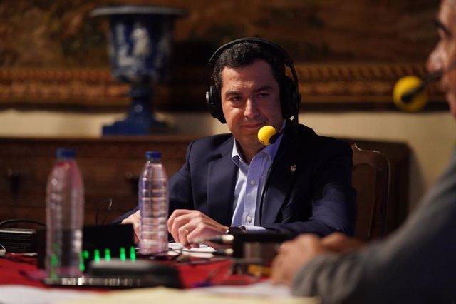 El presidente de la Junta de Andalucía, Juanma Moreno, en una entrevista en la Cadena SER este jueves.