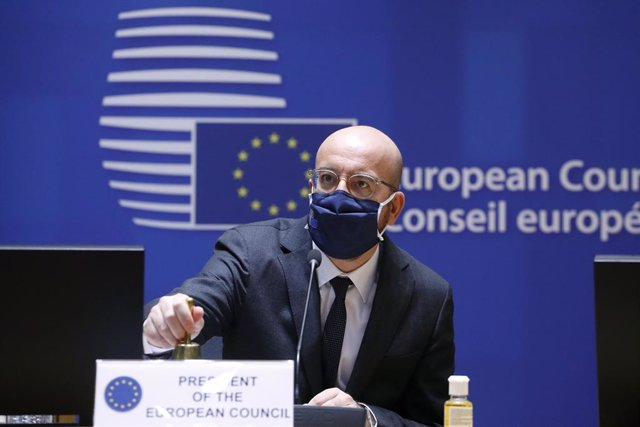 HANDOUT - 10 December 2020, Belgium, Brussels: EU Council President Charles Michel ringes a bell to start the first day of a two days face-to-face European Council summit. Photo: Dario Pignatelli/EU Council/dpa - ATTENTION: editorial use only and only if