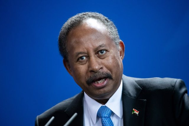 FILED - 14 February 2020, Berlin: Sudan's Prime Minister Abdalla Hamdok speaks during a press conference with German Chancellor Angela Merkel (not pictured) at the Federal Chancellery. Hamdok tweetted that he spoke with Josep Borrell, High Representative