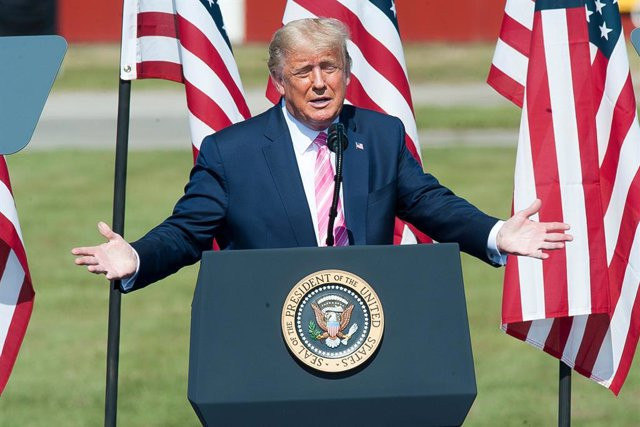 24 October 2020, US, Lumberton: US President Donald Trump greets speaks to his  supporters during the Fighting for the Forgotten Men and Women rally at the Robeson County Fairgrounds. Photo: Jason Moore/ZUMA Wire/dpa