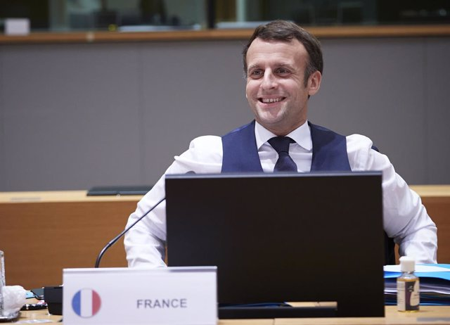 HANDOUT - 11 December 2020, Belgium, Brussels: French President Emmanuel Macron smiles at the end of a night of negotiations during a two days face-to-face European Council summit. Photo: Mario Salerno/EU Council/dpa - ATTENTION: editorial use only and on