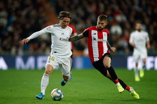 Luka Modric of Real Madrid and Inigo Martinez of Athletic Club during the spanish league, La Liga, football match played between Real Madrid and Athletic Club de Bilbao at Santiago Bernabéu Stadium on December 22, 2019 in Madrid, Spain.