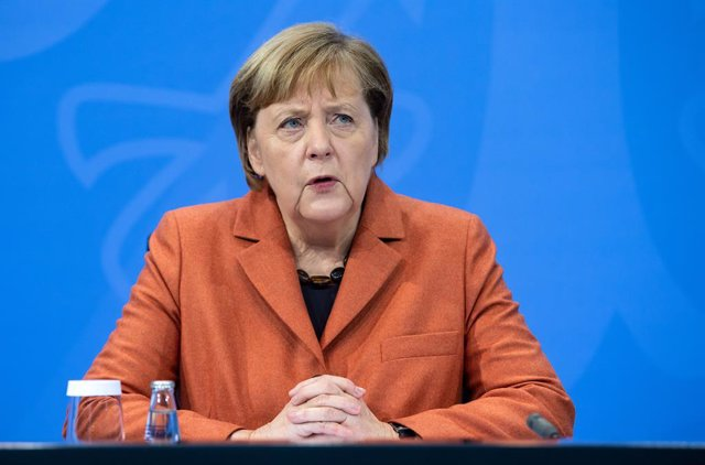 13 December 2020, Berlin: German Chancellor Angela Merkel speaks during a press conference at the Federal Chancellery following consultations with the heads of government of the federal states. In view of a surge in coronavirus infections, a nationwide ba