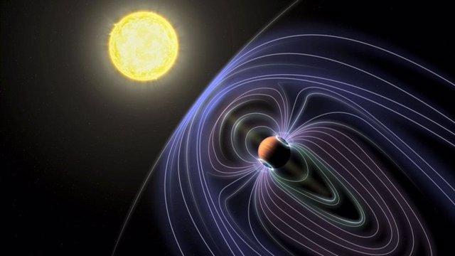 En esta representación artística del sistema Tau Boötes b, las líneas que representan el campo magnético invisible se muestran protegiendo al planeta Júpiter caliente del viento solar.