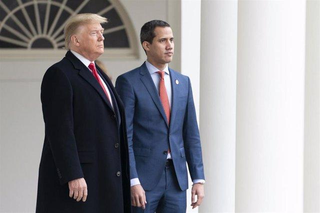 El presidente de Estados Unidos, Donald Trump, y el dirigente opositor venezolano, Juan Guaidó.
