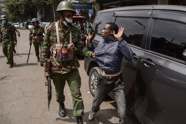 07 July 2020, Kenya, Nairobi: An officer from the General Service Unit (GSU) arrests a protestor during a protest against police brutality. Photo: Dennis Sigwe/SOPA Images via ZUMA Wire/dpa