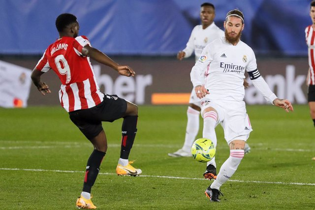15 December 2020, Spain, Madrid: Real Madrid's Sergio Ramos (R) and Athletic Bilbao's Inaki Williams battle for the ball during the Spanish La Liga soccer match between Real Madrid and Athletic Bilbao at Estadio Alfredo Di Stefano. Photo: Indira/DAX via Z