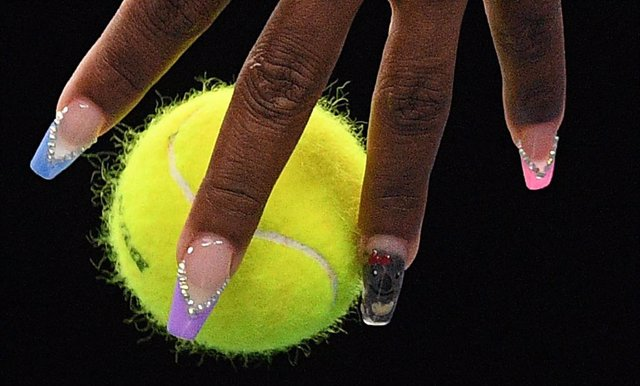 22 January 2020, Australia, Melbourne: US tennis player Serena Williams holds the ball before serving to Slovenia's Tamara Zidansek during their women's singels second round match, on day three of the Australian Open tennis tournament. Photo: Lukas Coch/A