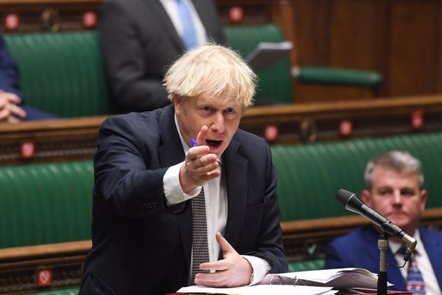 HANDOUT - 16 December 2020, England, London: UK Prime Minister Boris Johnson speaks during Prime Minister's Questions in the House of Commons. Photo: Jessica Taylor/Uk Parliament via PA Media/dpa - ATTENTION: editorial use only and only if the credit ment