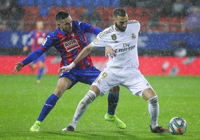 Karim Benzema, player of Real Madrid from France,  and Edu Exposito, player of Eibar from Spain, fight for the ball during the spanish league La Liga football match played between SD Eibar and Real Madrid CF  at Municipal de Ipurua Stadium on November 09,