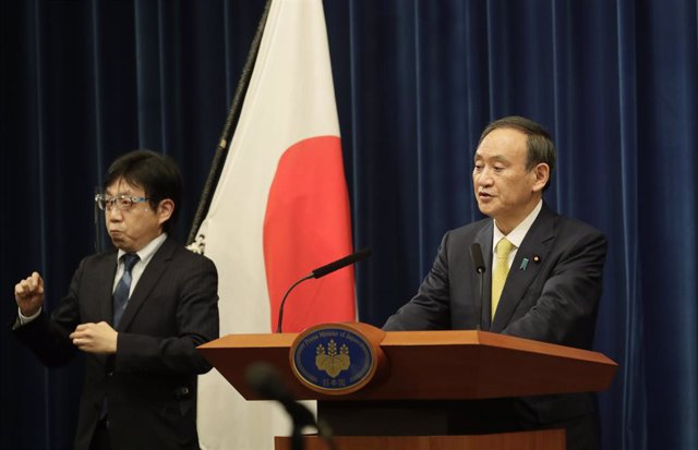 04 December 2020, Japan, Tokyo: Japanese Prime Minister Yoshihide Suga (R) speaks during a press conference. Photo: -/Pool Photo via ZUMA Wire/dpa