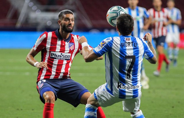 "Cristian Portugues ""Portu"" of Real Sociedad and Yannick Carrasco of Atletico de Madrid fight for the ball during the spanish league, La Liga, football match played between Atletico de Madrid and Real Sociedad at Wanda Metropolitano Stadium on July 19, 202"