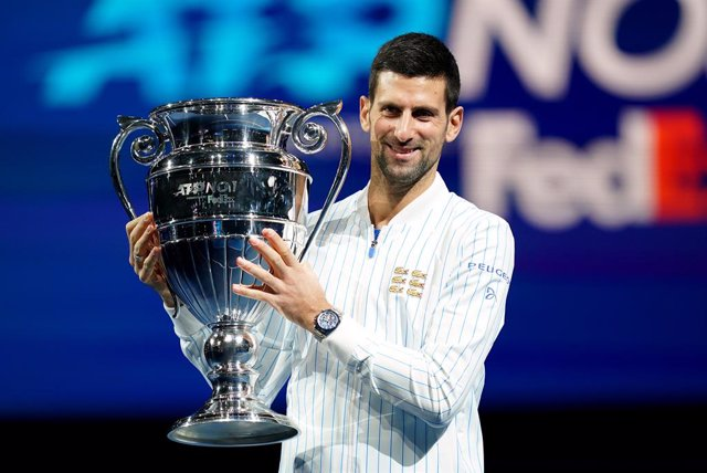15 November 2020, England, London: Serbian tennis player Novak Djokovic poses with his year end ATP number one trophy on the first day of the ATP World Tour Finals tennis tournament at the O2 Arena. Photo: John Walton/PA Wire/dpa