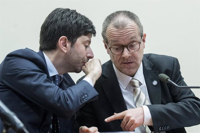 26 February 2020, Italy, Rome: Roberto Speranza (L), Italian Minister of Health, speaks with Hans Kluge, Chief of World Health Organization Europe Region, during the Coronavirus Summit with representatives of the EU, WHO and ECDC.