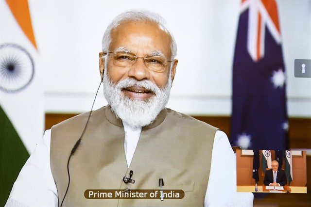 Australian Prime Minister Scott Morrison and Indian Prime Minister Narendra Modi are seen on a conference screen during the 2020 Virtual Leaders Summit between Australia and India at Parliament House in Canberra, Thursday, June 4, 2020. (AAP Image/Lukas C