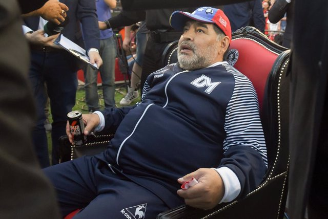 29 October 2019, Argentina, Rosario: Argentinian Coach and former football player Diego Maradona sits in an armchair. Newell's football team gave Maradona as a tribute a picture as a player in the team. Photo: Sebastian Granata/telam/dpa