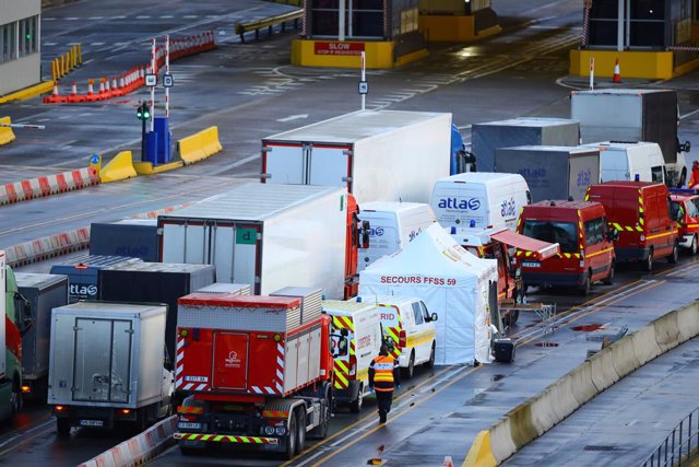 24 December 2020, England, Dover: Vehicles move into the departure area at the port of Dover where coronavirus (COVID-19) tests are carried out, travellers must show a negative test result carried out within the past 72 hours in order to be able to cross