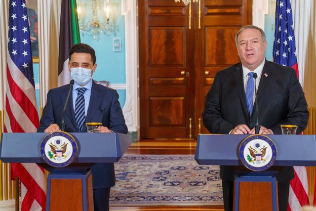 HANDOUT - 24 November 2020, US, Washington: US Secretary of State Mike Pompeo (R) and Kuwaiti Foreign Minister Sheikh Ahmad Nasser al-Mohammad al-Sabah hold a joint press conference following their meeting at the US Department of State. Photo: Ron Przysuc