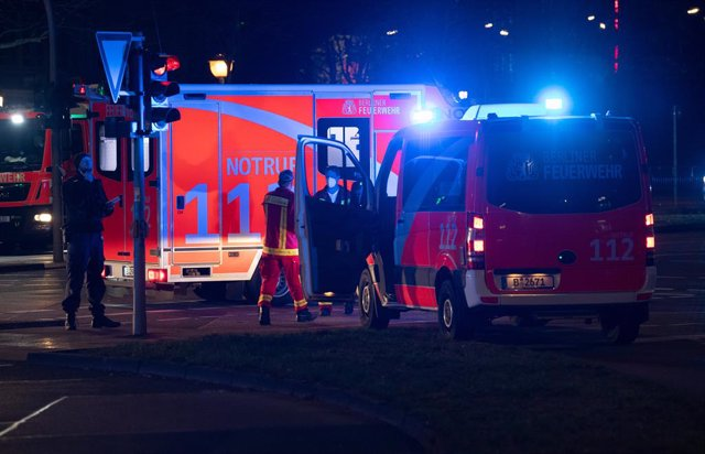 26 December 2020, Berlin: Emergency vehicles of the fire department are parked in Stresemann street after a shooting in the early morning. According to initial information, four people were injured, some of them seriously. Photo: Paul Zinken/dpa