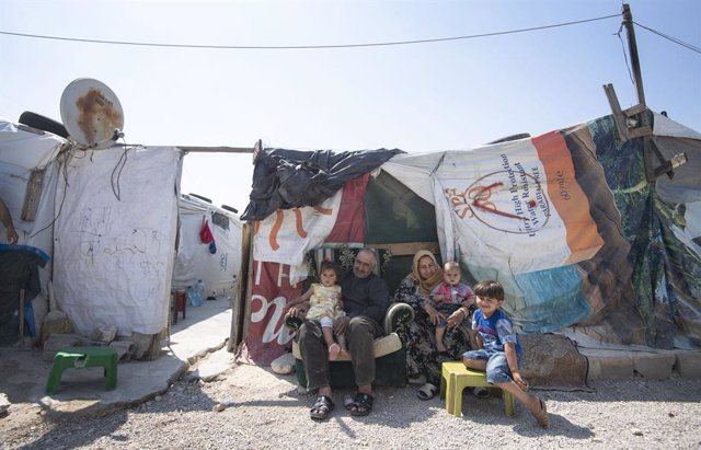 12 June 2019, Lebanon, ---: Members of a refugee family sit outside their tente during the visit of Sophie (not pictured), the Countess of Wessex, to an informal tented settlement, which houses refugees displaced to Lebanon by the Syrian conflict. Photo: