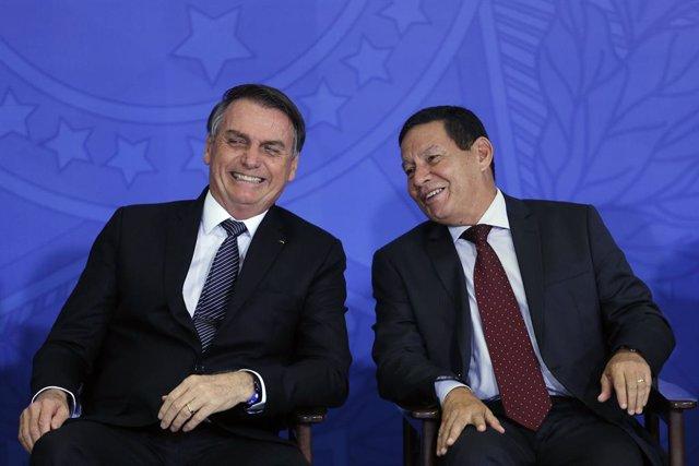 24 April 2019, Brazil, Brasilia: Brazilian President Jair Bolsonaro and Vice President Hamilton Mourao attend a Governmental event at the Planalto Palace. Photo: -/GDA via ZUMA Wire GDA via ZUMA Wire/dpa