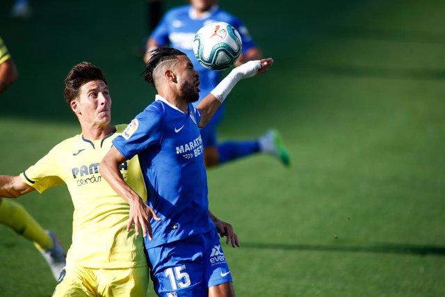 Pau Torres (Villarreal) y Youssef En-Nesyri (Sevilla)
