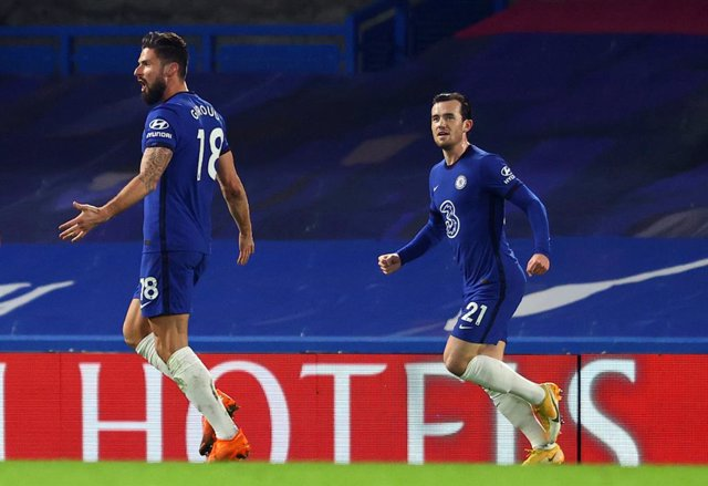 28 December 2020, England, London: Chelsea's Olivier Giroud (L) celebrates scoring the opening goal with teammate Ben Chilwell during the English Premier League soccer match between Chelsea and Aston Villa at Stamford Bridge. Photo: Richard Heathcote/PA W