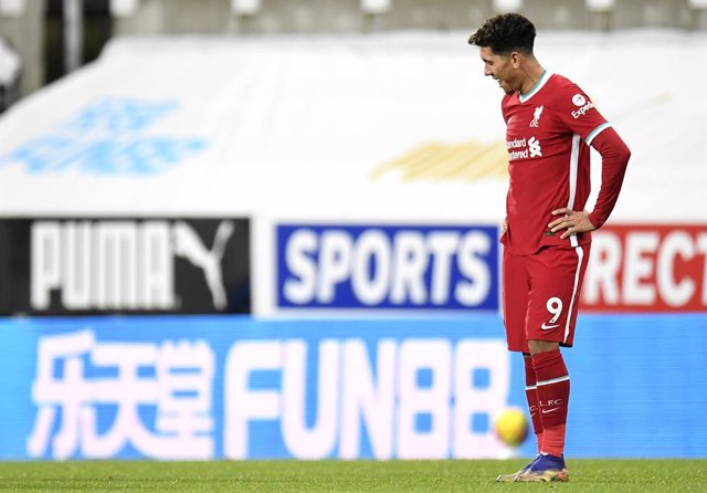30 December 2020, England, Newcastle: Liverpool's Roberto Firmino reacts after the final whistle of the English Premier League soccer match between Newcastle United and Liverpool at James' Park. Photo: Peter Powell/PA Wire/dpa