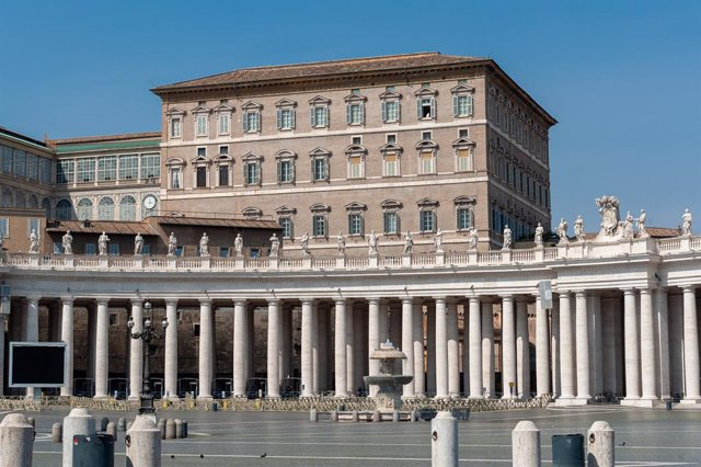 March 22, 2020 - Vatican City, Vatican:  Pope Francis looks out the window of the Apostolic Palace, after the television broadcast of the noon Angelus prayer, in a completely empty St. Peter's Squar, due to the government restrictions of the Covid19 epide