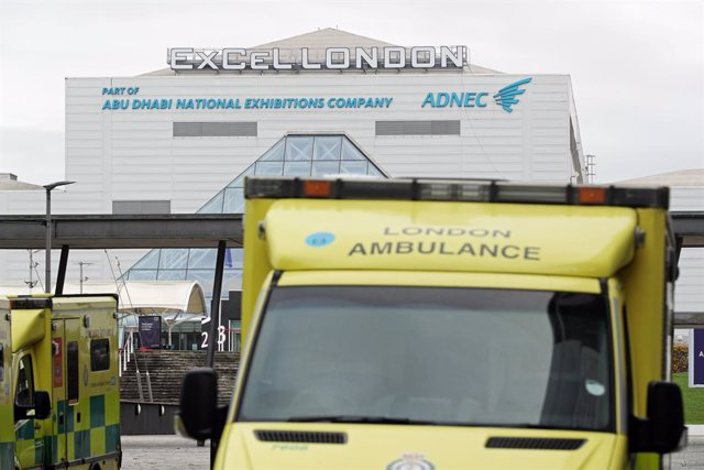 02 January 2021, England, London: Ambulances are seen parked outside the ExCeL in east London which is the site of one of a number of Nightingale hospitals prepared last year at the start of the coronavirus pandemic and which the NHS says is being reactiv