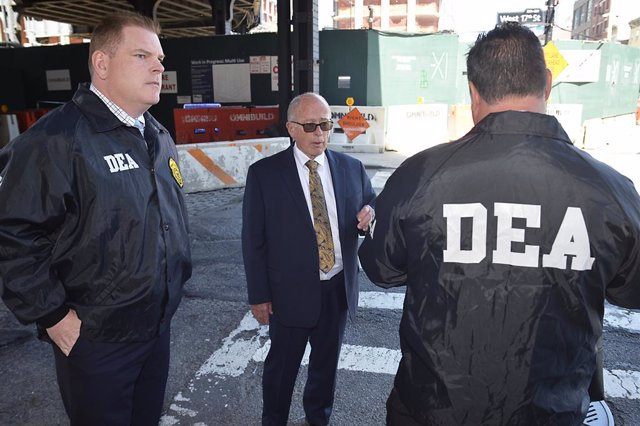 """April 23, 2019 - New York, New York, United States: Drug Enforcement Administration (DEA) agents lead former chief executive of the Rochester Drug Cooperative (RDC) Laurence """"Larry"""" F. Doud III into their NYC office after he turned himself in to face felo"""