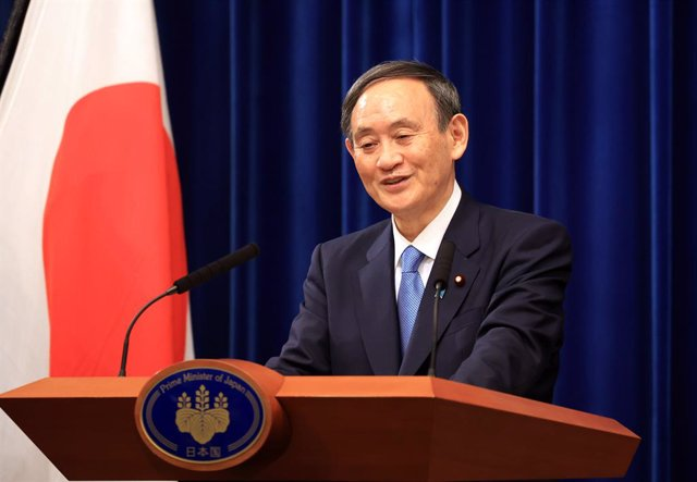 04 January 2021, Japan, Tokyo: Japanese Prime Minister Yoshihide Suga speaks during a press conference at his official residence. Japan will consider declaring a state of emergency over the Covid-19 pandemic for Tokyo and its surrounding prefectures. Phot