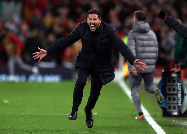 11 March 2020, England, Liverpool: Atletico Madrid's manager Diego Simeone celebrates after Marcos Llorente (not pictured) scored his side's second goal during the UEFA Champions League round of 16 second leg soccer match between Liverpool and Atletico Ma