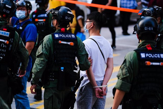 06 September 2020, China, Hong kong: Riot cops detain a protester during an anti government protest after the government delayed a Legislative Council election for one year citing the coronavirus (COVID-19). Photo: Keith Tsuji/ZUMA Wire/dpa