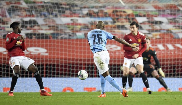 06 January 2021, England, Manchester: Manchester City's Fernandinho scores his side's second goal during the English Carabao Cup Semi-Final soccer match between Manchester United and Manchester City at the Old Trafford. Photo: Peter Powell/PA Wire/dpa