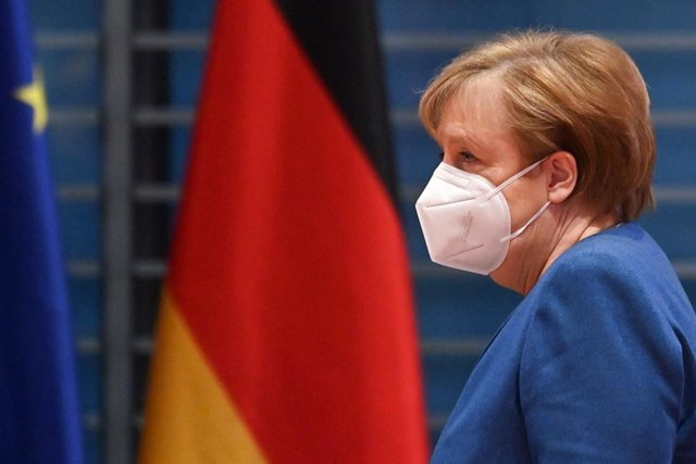 06 January 2021, Berlin: German Chancellor Angela Merkel wearing a face mask arrives to attend the cabinet meeting at the Federal Chancellery. Photo: John Macdougall/POOL afp/dpa