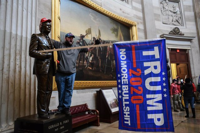 06 January 2021, US, Washington: A protester shouts inside the USCapitol after supporters of US President Donald Trump stormed the building where lawmakers were due to certify president-elect Joe Biden's win in the November election.