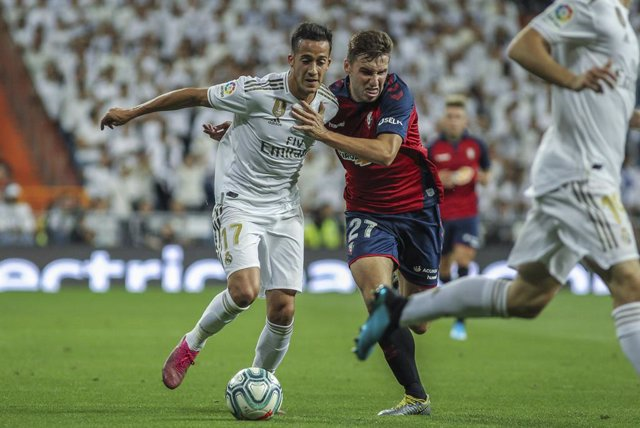 Lucas Vazquez of Real Madrid and Moncayola of Osasuna in action during La Liga Spanish championship football match between Real Madrid and Osasuna, September 25th, at Santiago Bernabeu stadium, in Madrid, Spain.