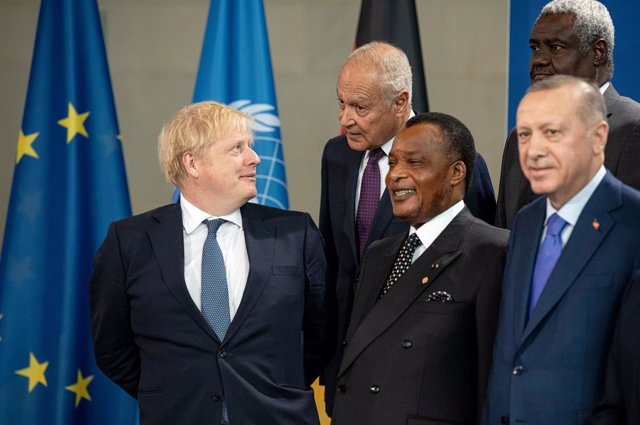 19 January 2020, Berlin: (L-R) British Prime Minister Boris Johnson, Secretary General of the Arab League Ahmed Aboulgheit, President of the Congo Denis Sassou Nguesso, Chairman of the African Union Moussa Faki and Turkish President Recep Tayyip Erdogan s