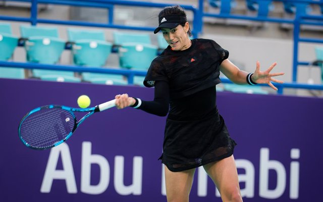 Garbine Muguruza of Spain in action during her first-round match at the 2021 Abu Dhabi WTA Womens Tennis Open WTA 500 tournament against Kristina Mladenovic of France