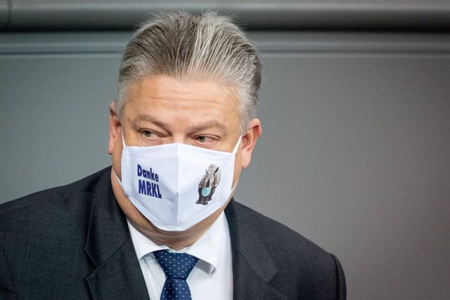 "30 October 2020, Berlin: Alternative for Germany (AfD) member of the Bundestag Thomas Seitz wears a face mask with the inscription ""Danke MRKL"" (Thank you MRKL) during a plenary session at the German Bundestag. Photo: Kay Nietfeld/dpa"
