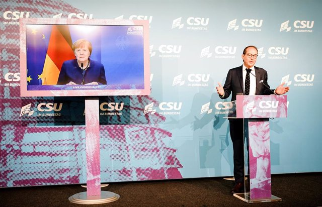 07 January 2021, Berlin: German Chancellor Angela Merkel (on screen) and Alexander Dobrindt, head of the Christian Social Union in Bavaria (CSU) parliamentary group, make a statement on the storming of the US Capitol by Trump supporters in Washington at t