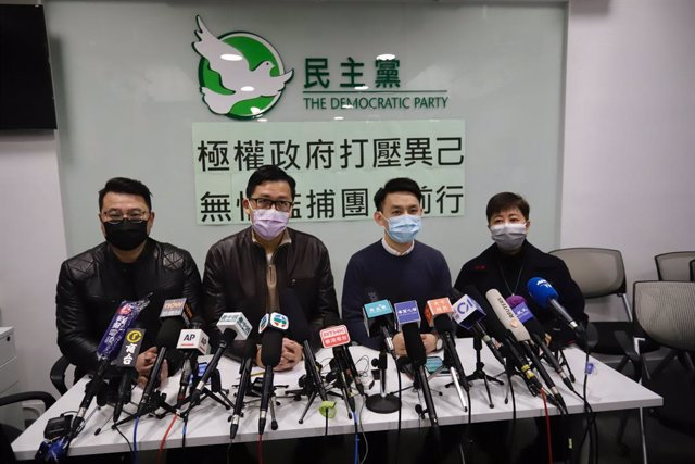 08 January 2021, China, Hong Kong: Chairman of the Democratic party Lo Kin-hei (2nd R), and former party leader lawmaker Lam Cheuk-ting speaks during a press conference at the party's headquarter to explain what had happened during detention at police sta